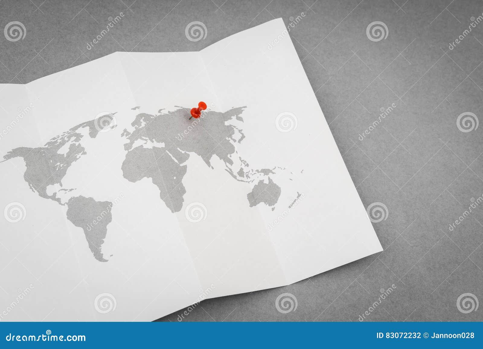 Mapa del mundo doblado papel con pin pointer rojo foto de - Papel pintado mapa del mundo ...