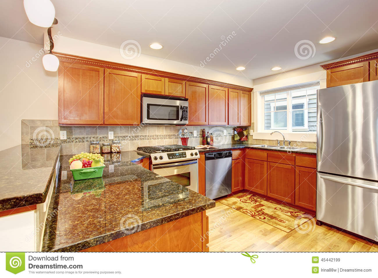 Maple Kitchen Cabinets With Steel Appliances And Granite