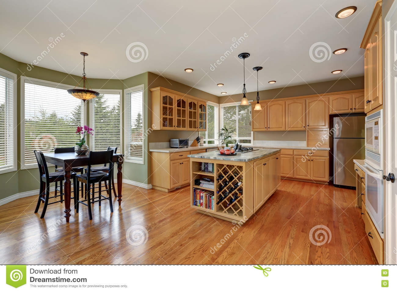maple storage combination and large island in the kitchen room maple storage combination and large island in the kitchen room stock photo