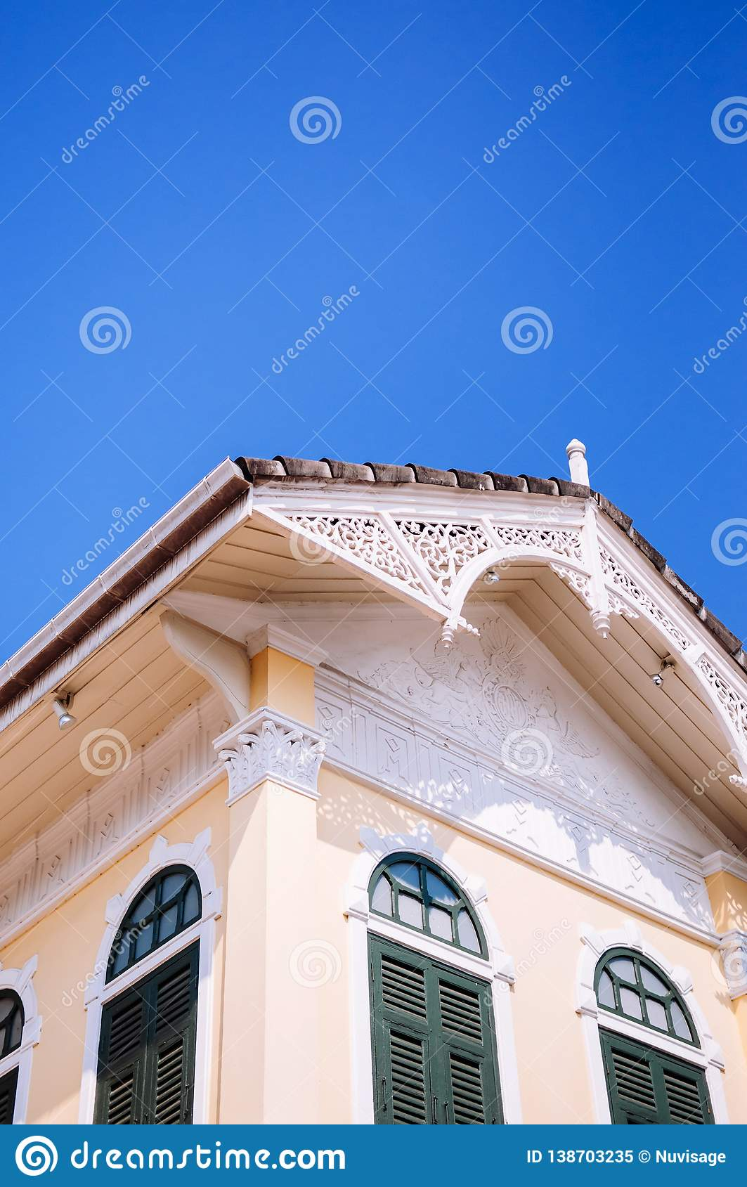 Wooden facade of Victorian style Gingerbread house, Colonial building
