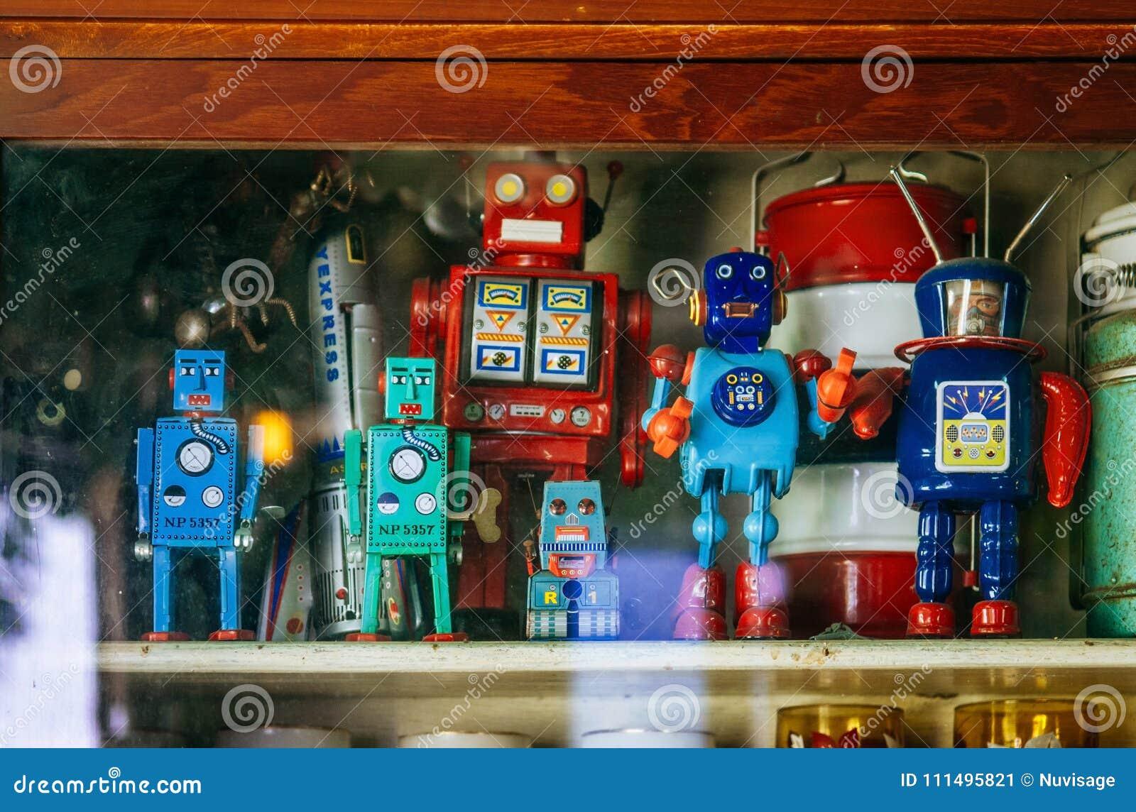 Group of colourful vintage retro tin toy robot team