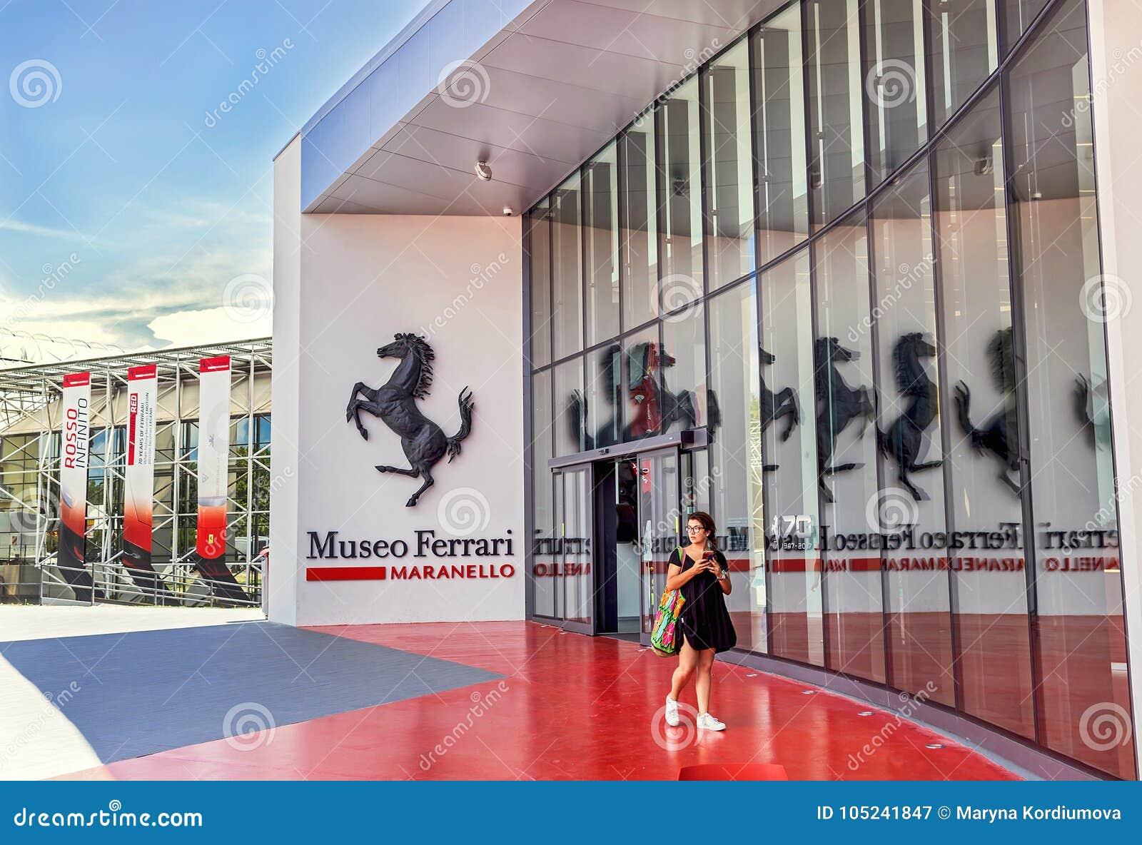 Maranello, Italy – July 26, 2017: Girl near main entrance to famous, popular Ferrari museum (Enzo Ferrari).