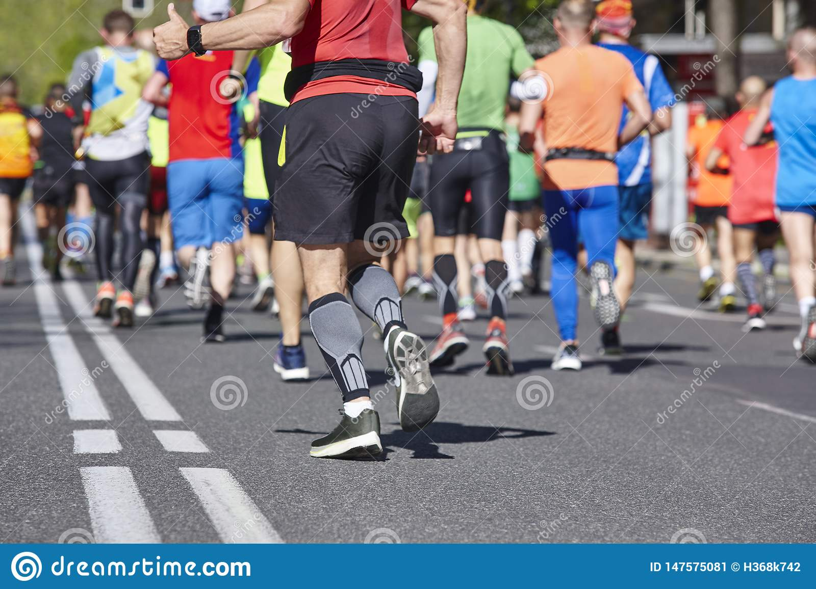 7984da31c06da Marathon Runners On The Street. Healthy Lifestyle. Athletes Stock ...