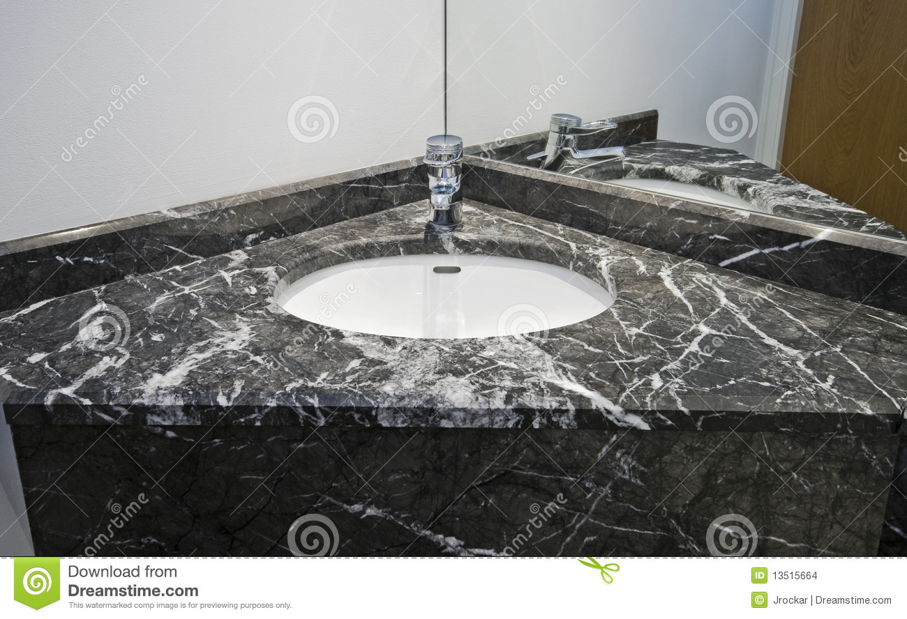 Black contemporary marble hand wash basin with chrome tap.