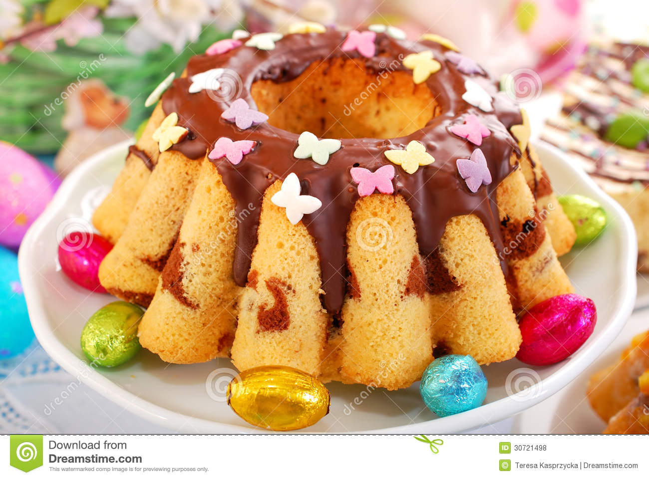 Marble ring cake with chocolate sauce and colorful butterfly shape ...