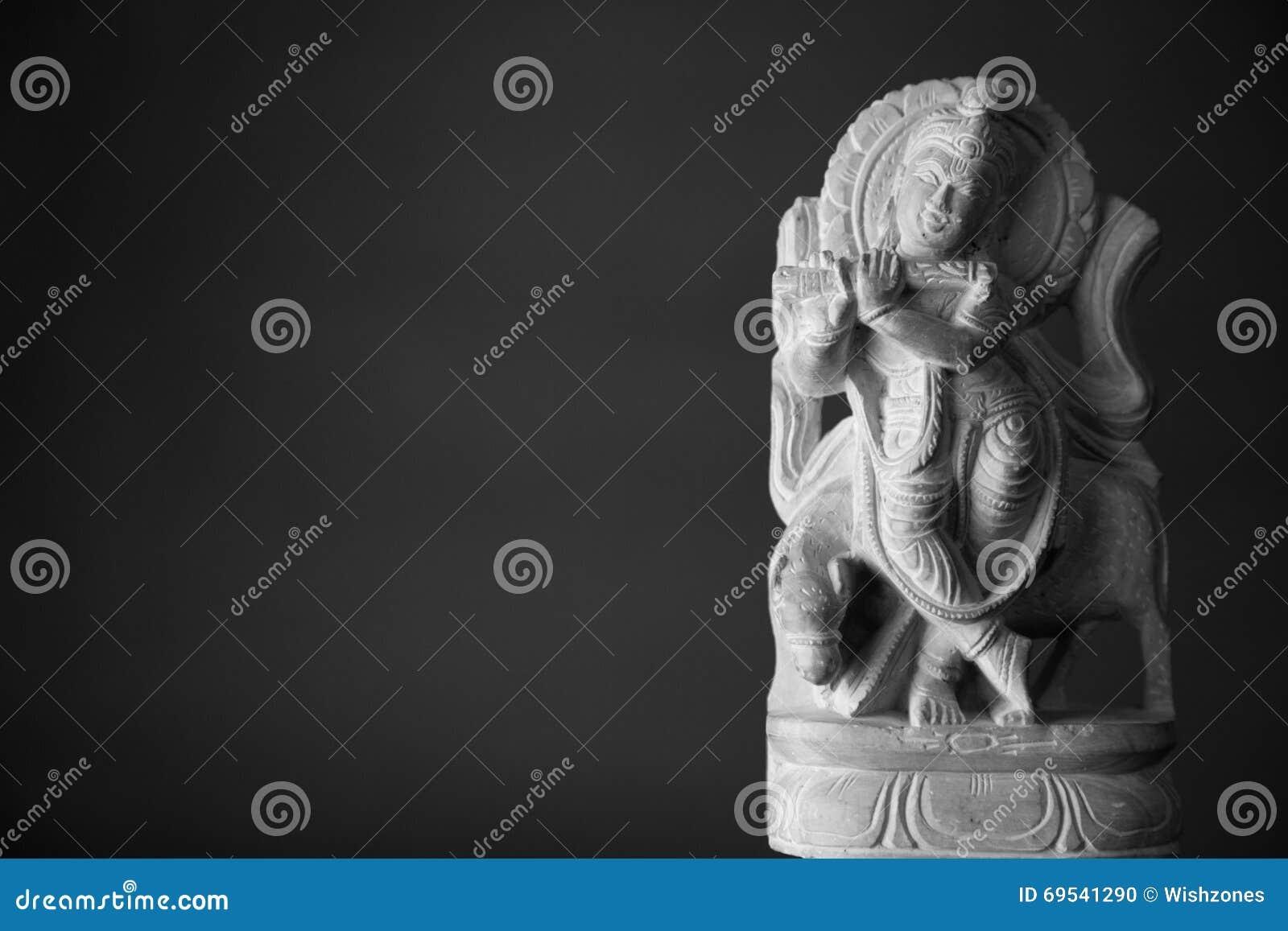 Marble Statue Of God Krishna Stock Photo