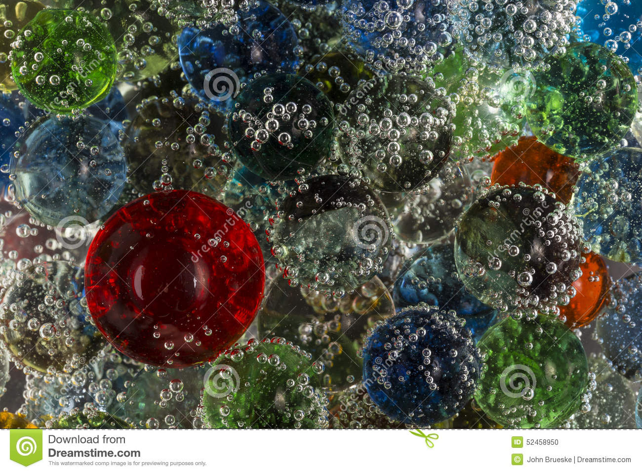 Marbles In Bubbly Soda Stock Photo - Image: 52458950