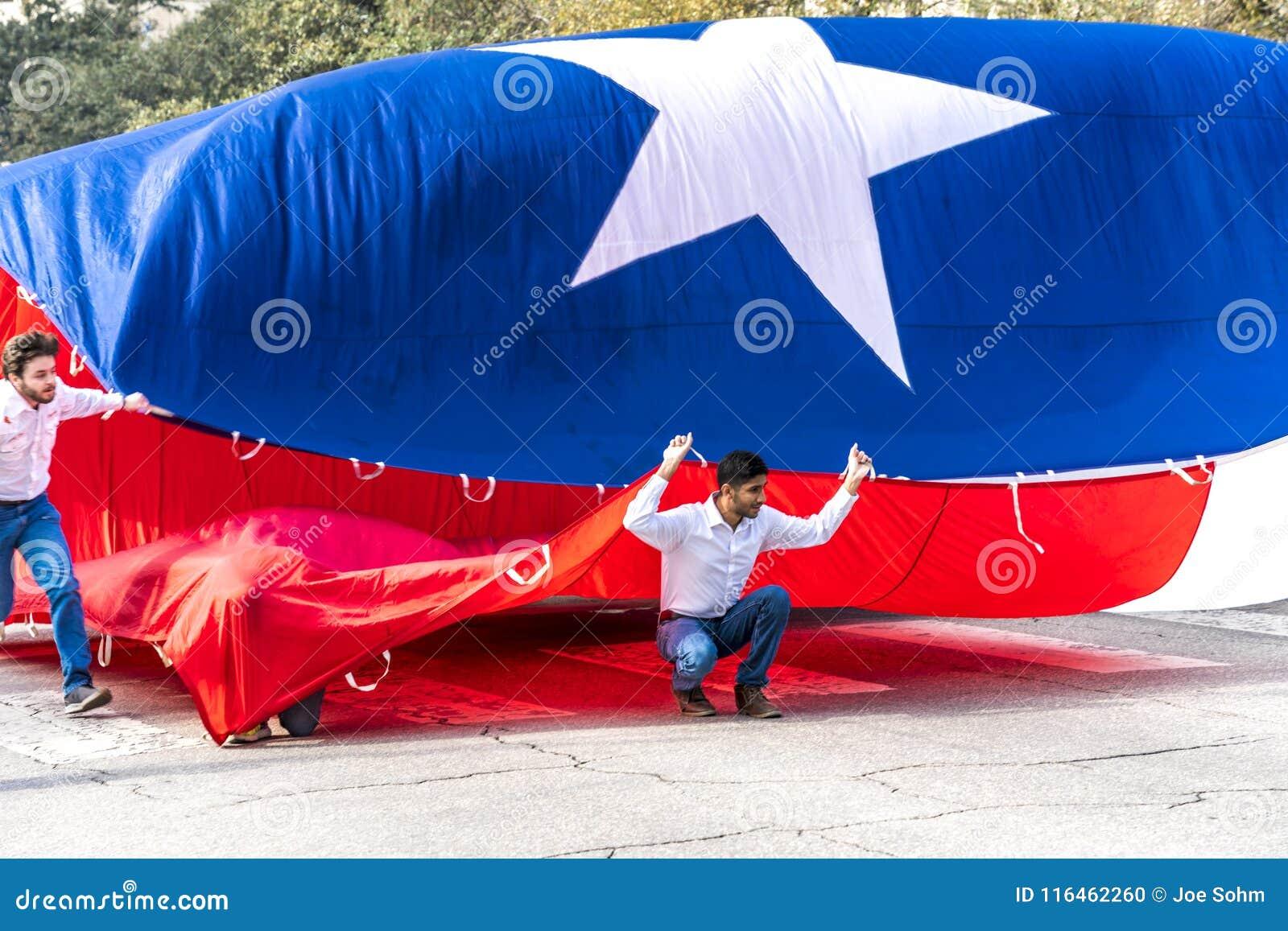 MARCH 3, 2018 - AUSTIN TEXAS - University of Texas students carry Texas flag down Congress Avenue. Mexico, Annual