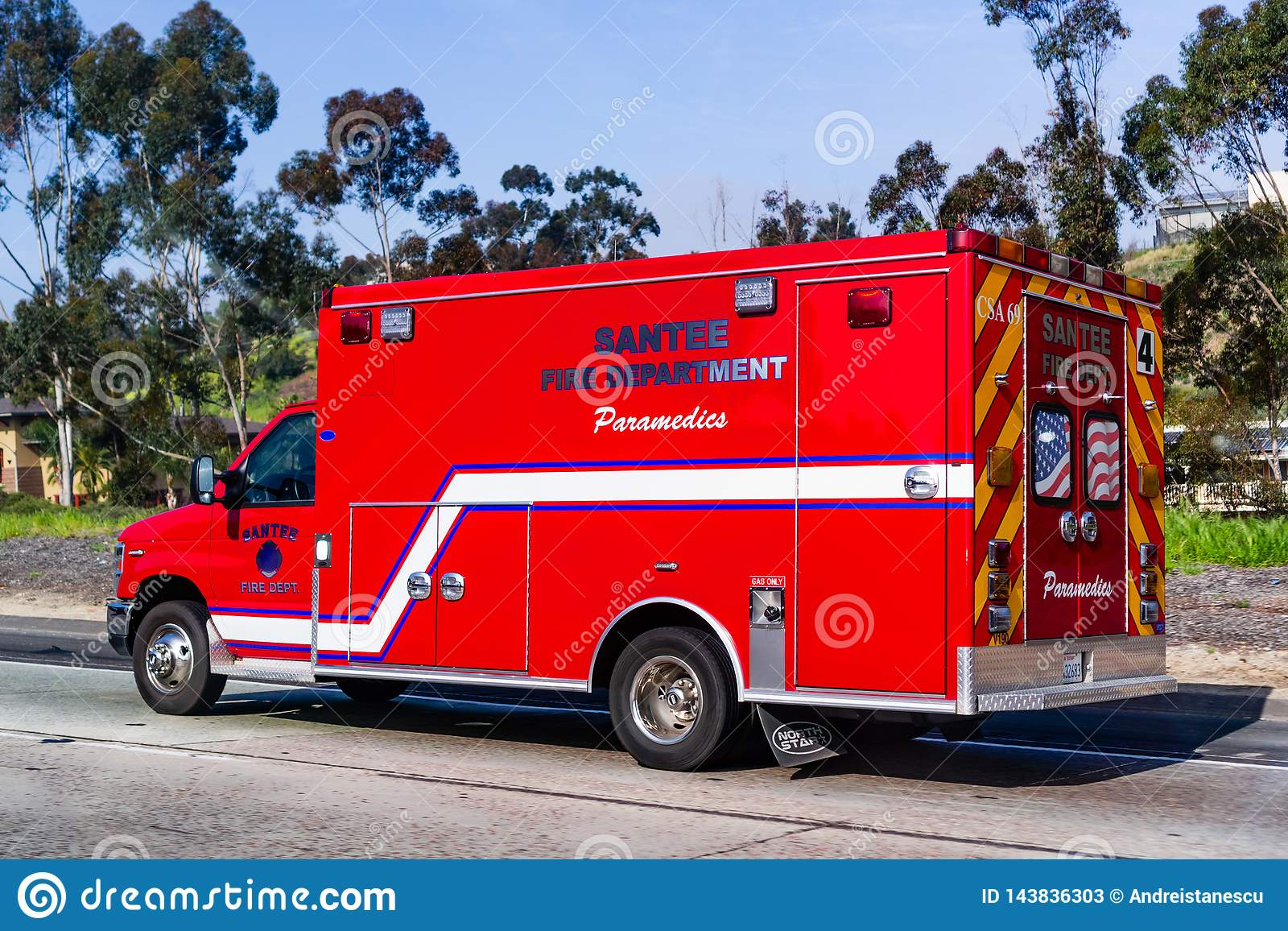 March 19, 2019 Santee / CA / USA - Fire Deparment Paramedics Vehicle driving on a street