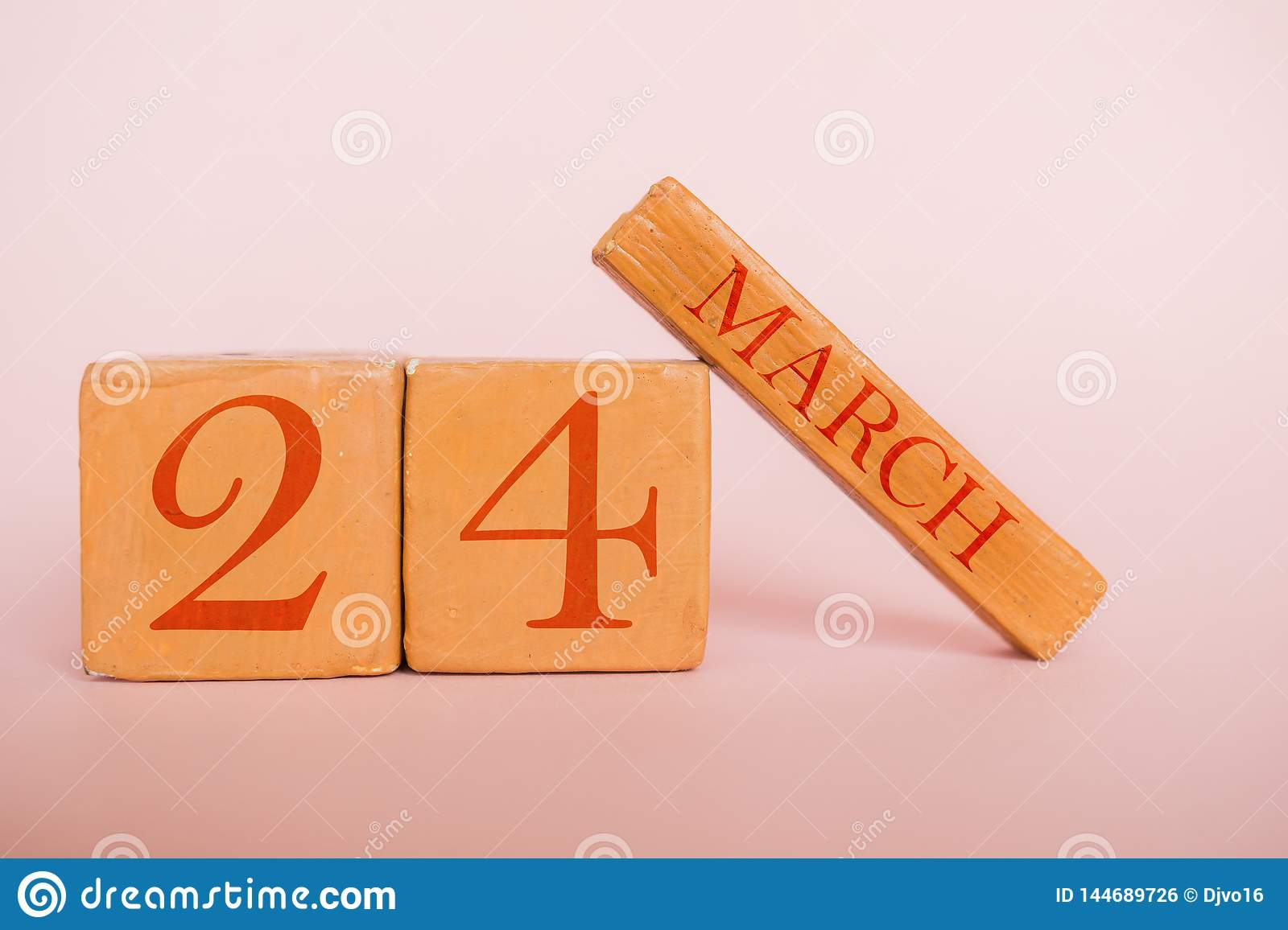 march 24th. Day 24 of month, handmade wood calendar  on modern color background. spring month, day of the year concept
