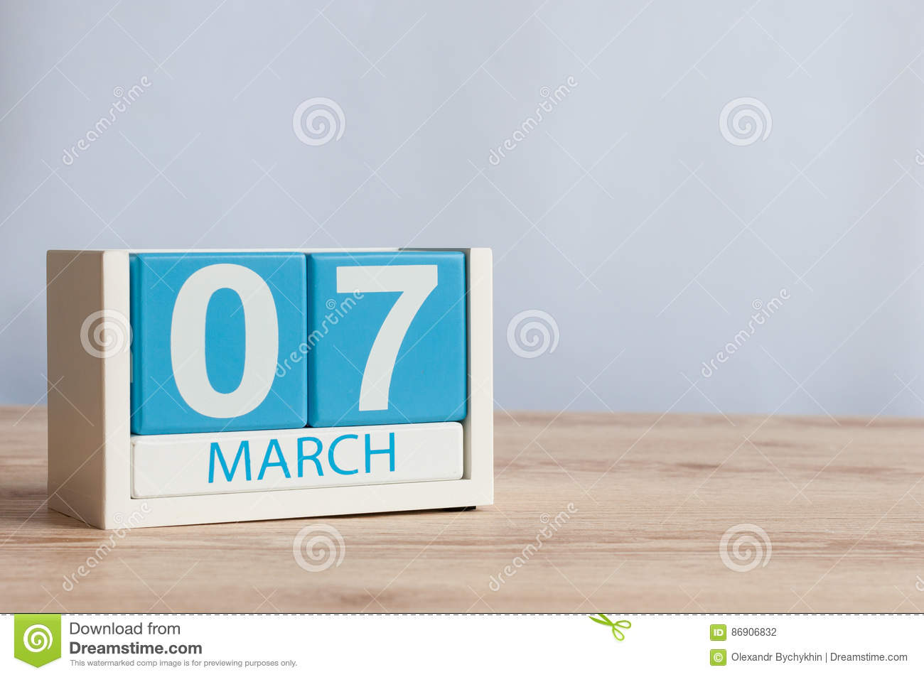 March 7th. Day 7 of month, wooden color calendar on table background. Spring day, empty space for text