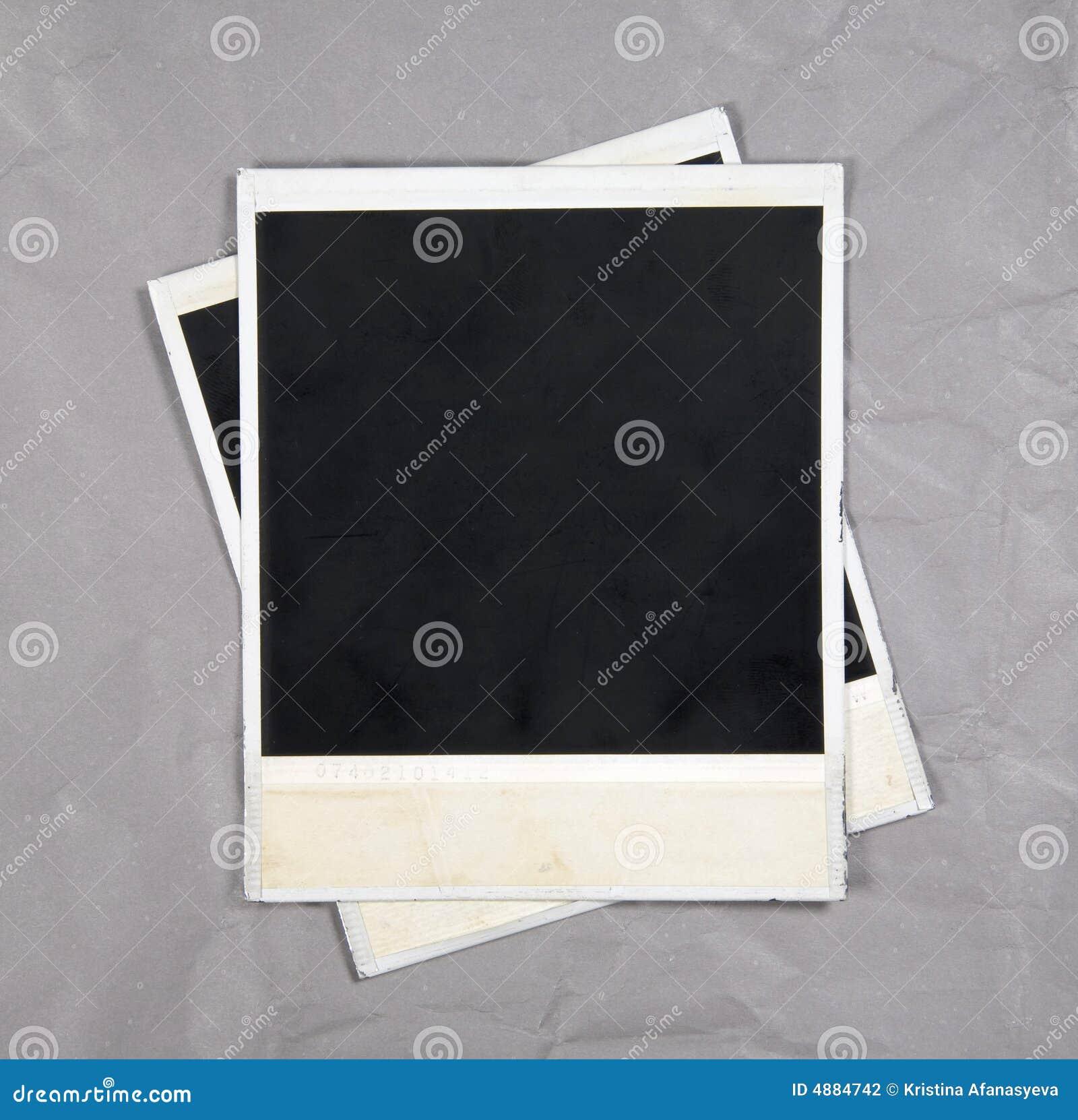 Marcos de la foto en el fondo de papel