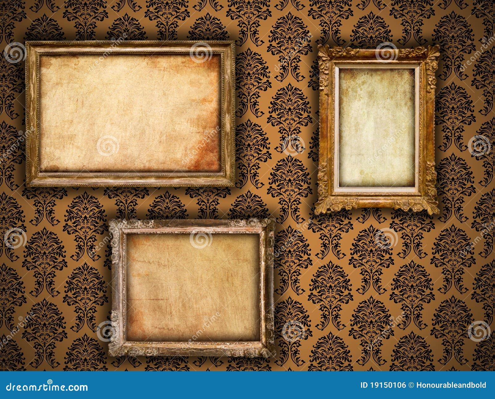 Marcos dorados de la vendimia en el papel pintado del damasco