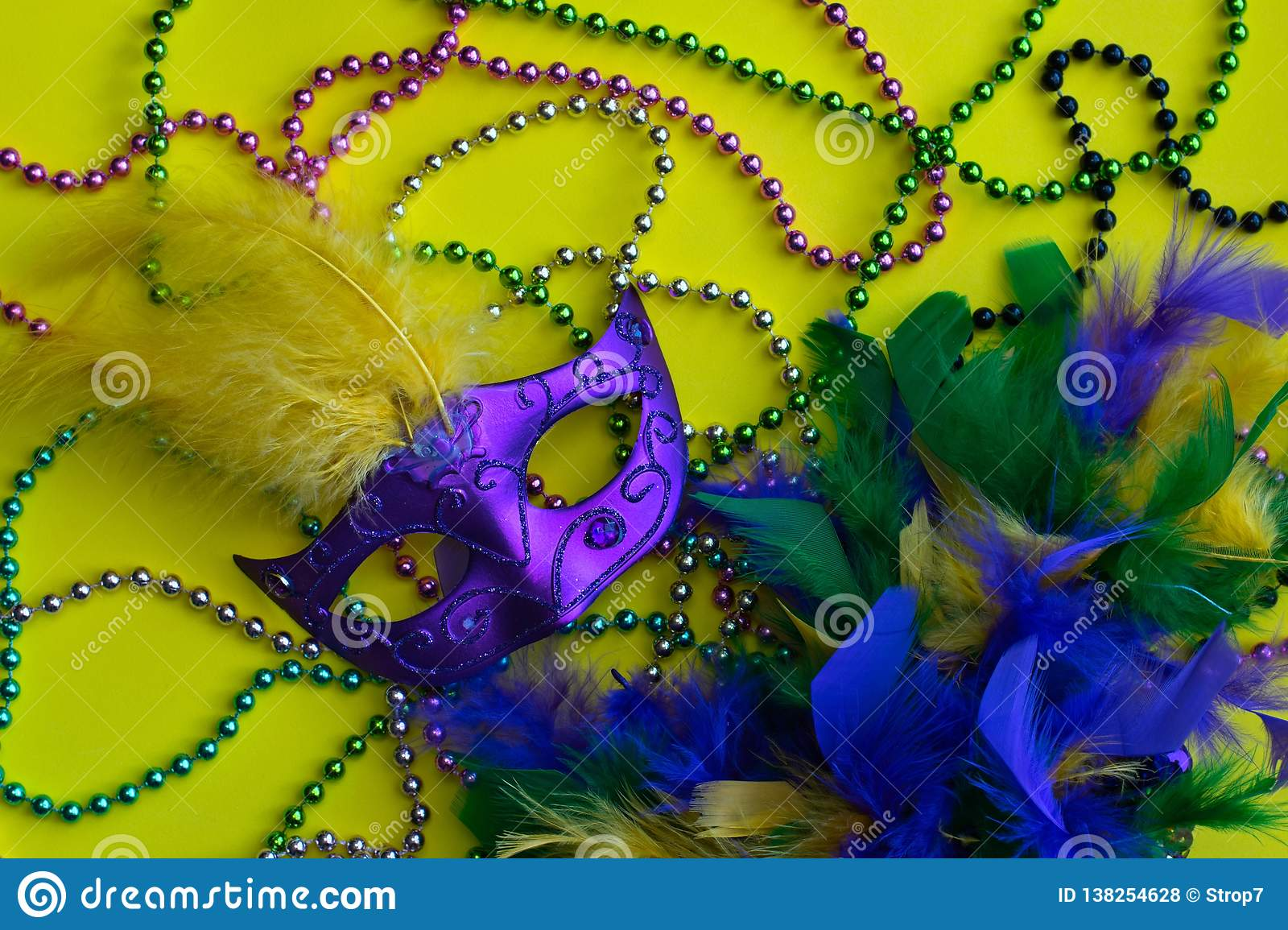 Mardi Gras beads, mask and boa.