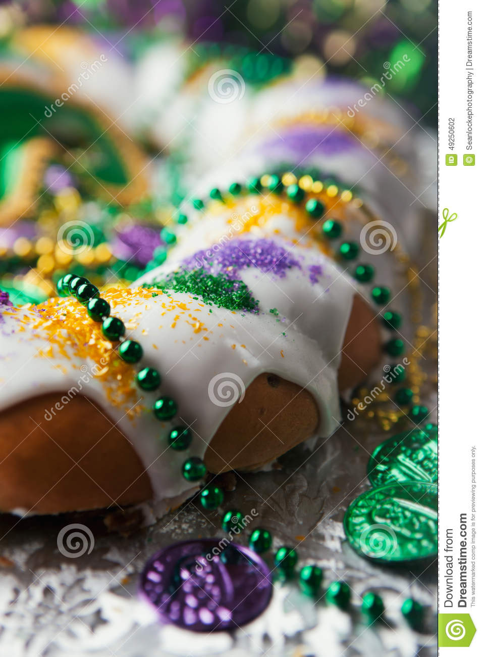 Mardi Gras: Traditional King Cake With Beads And Coins