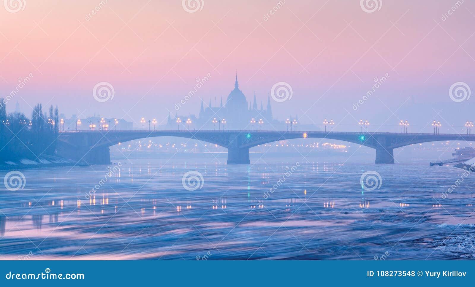 Margaret bridge against Parliament outline in winter, Budapest