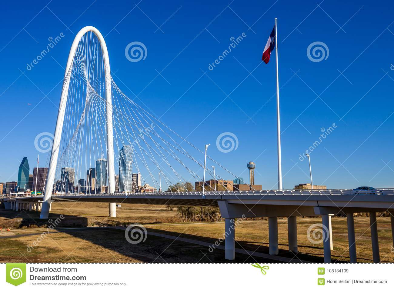 Margaret Hunt Hill Bridge with the Texas flag and Dallas skyline in the background