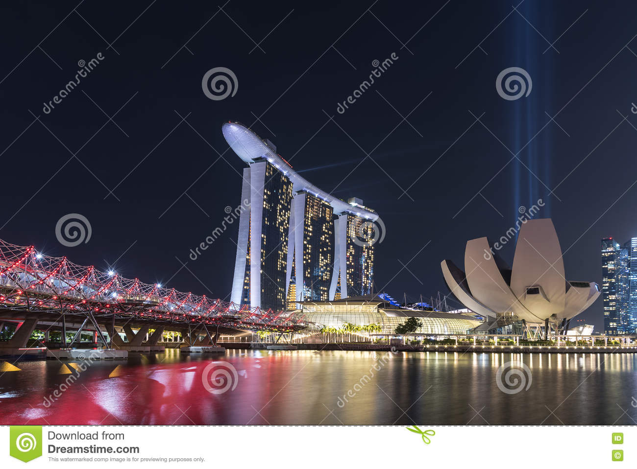 marina bay sands at night with light and water show editorial image