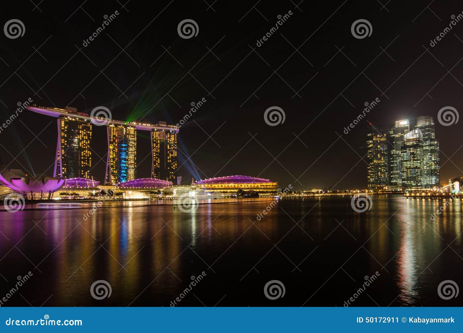 Marina Bay Singapore With Laser Lights Green And Blue Night Black Sky Beauti