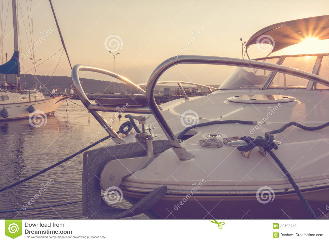 Marina with docked yachts at the sunset. Yachting. Sailing. Travel Concept. Vacation