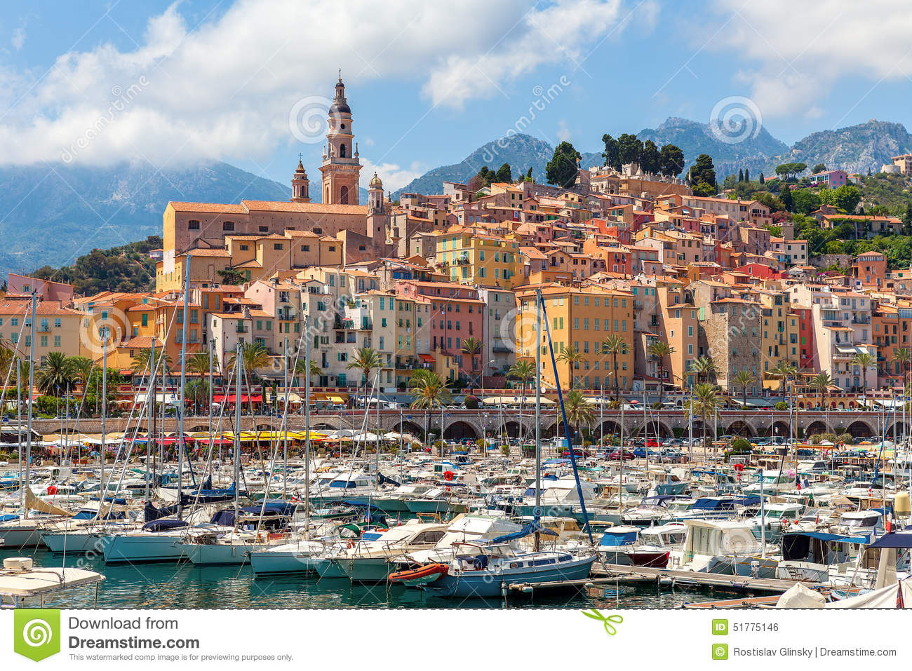 Old colorful houses overlooking small marina with yachts and boats in ...