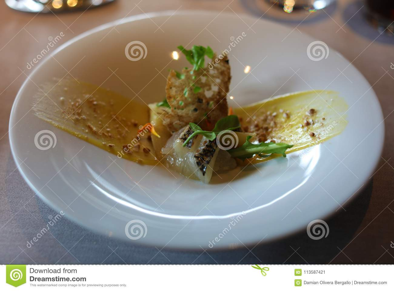 Marinated sea bream with bergamot and lemon sause, luxury meal unique cuisine in VIP gastronomy restaurant