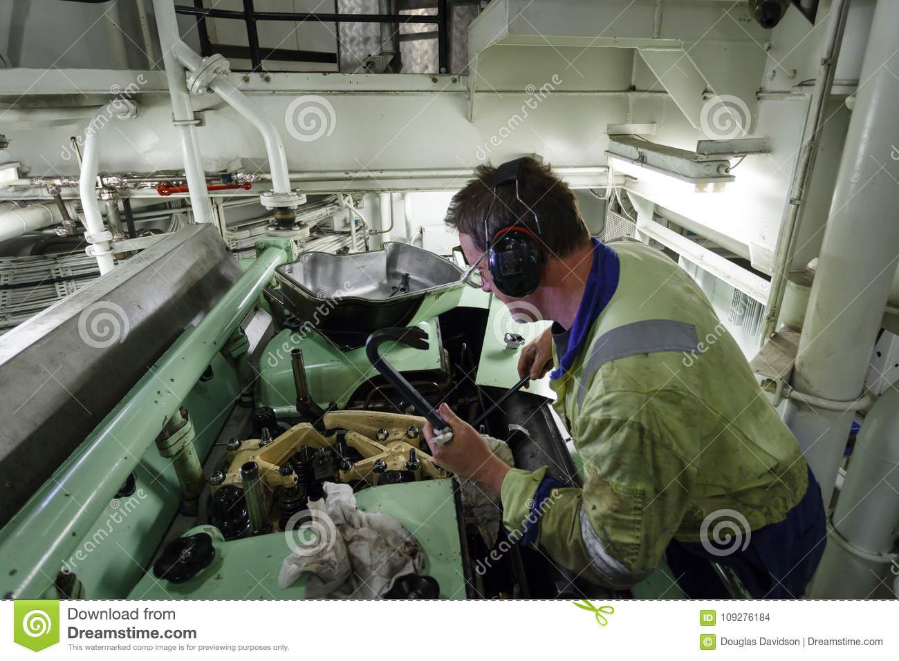download marine engineer changing a diesel fuel injector stock photo image of changing machine
