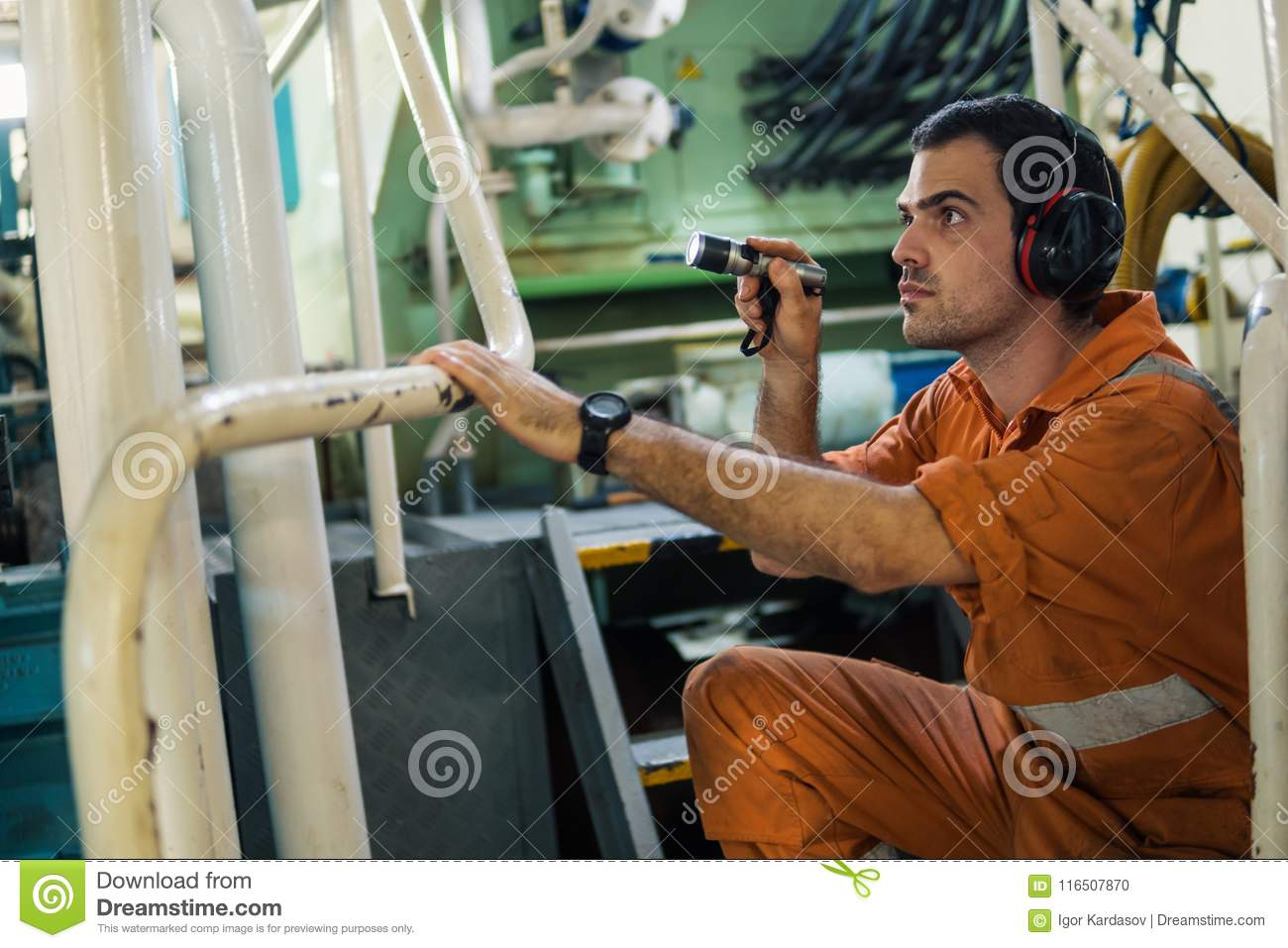 Marine Engineer Inspecting Ship`s Engine In Engine Control Room