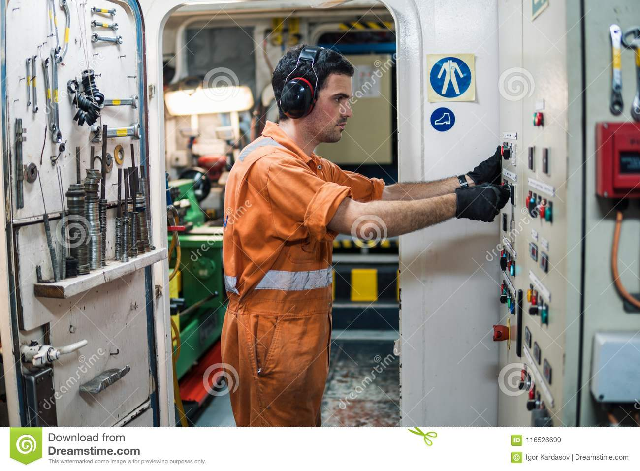 Marine Engineer Officer Controlling Vessel Engines In Engine Control