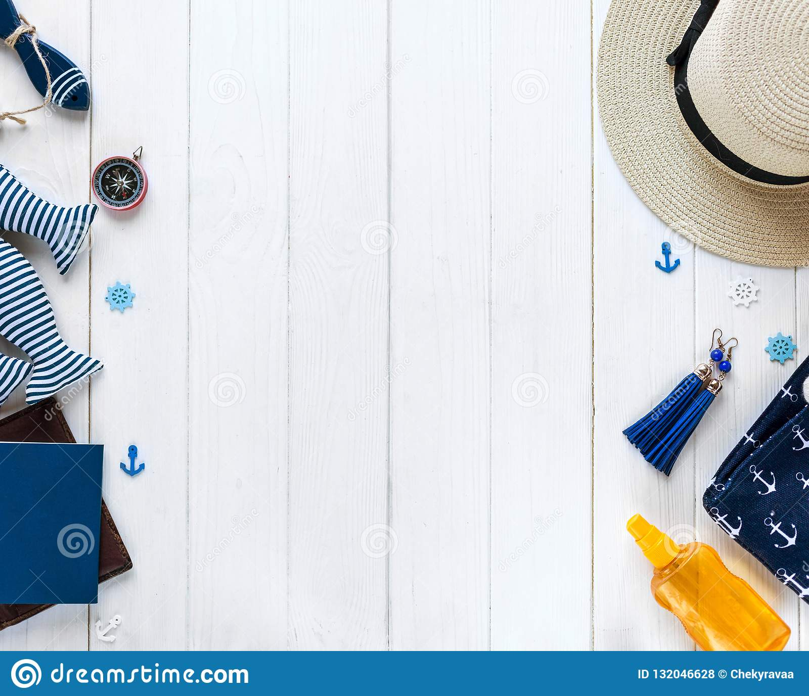 Marine items on wooden background. Sea objects: straw hat, swimsuit, fish, shells . flat lay, copy space. vacation and travel