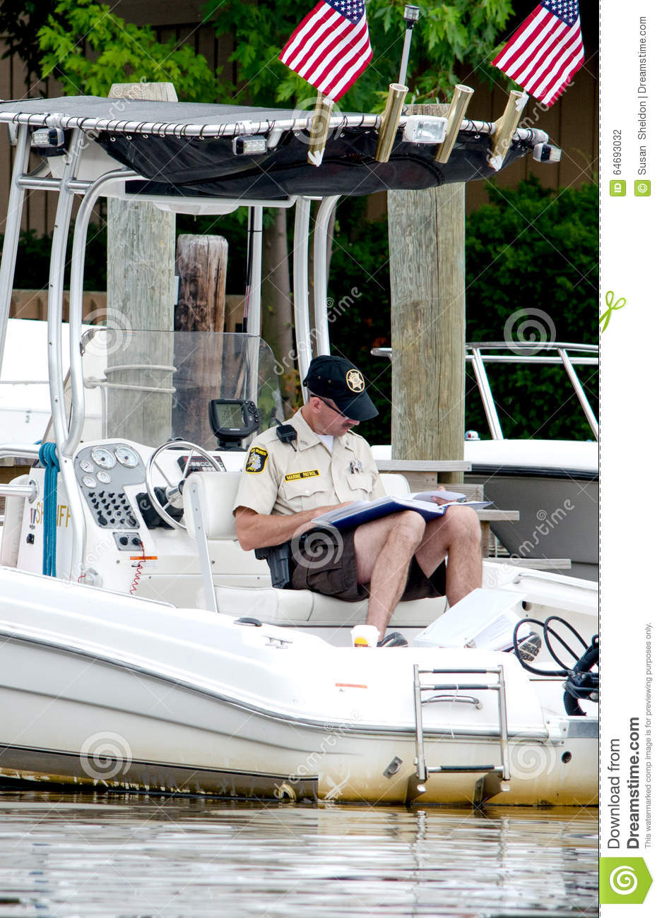 Marine police on the job editorial photography  Image of officer