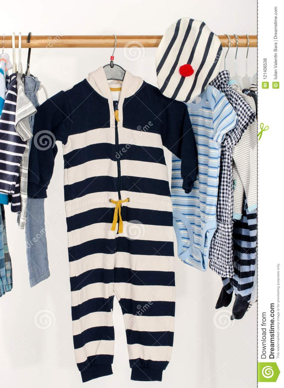 eebb57153794 Dressing Closet With Baby Striped Clothes Arranged On Hangers. Stock ...