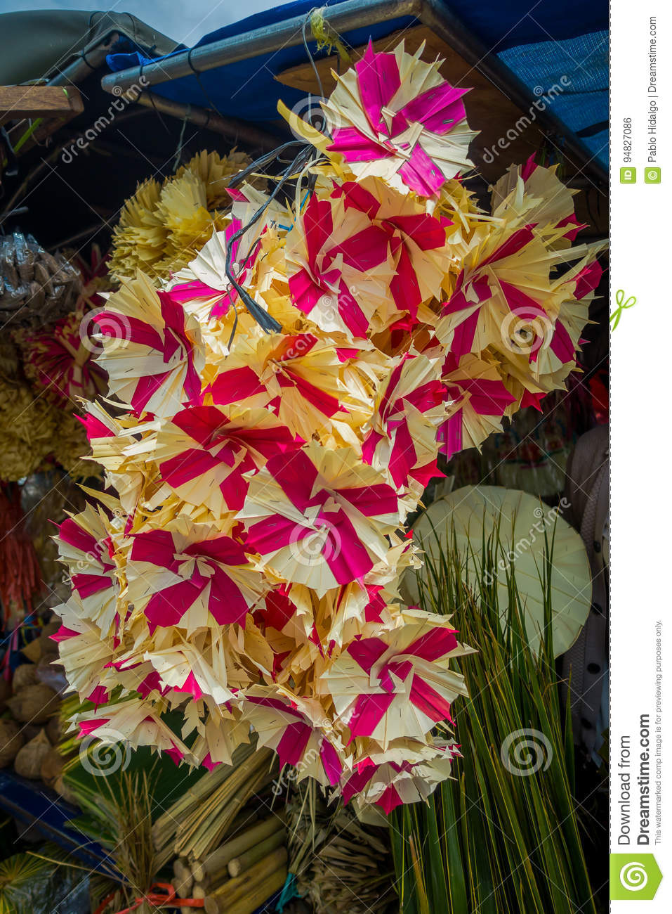 A market with an arrangement of flowers made of paper, in the city of Denpasar in Indonesia