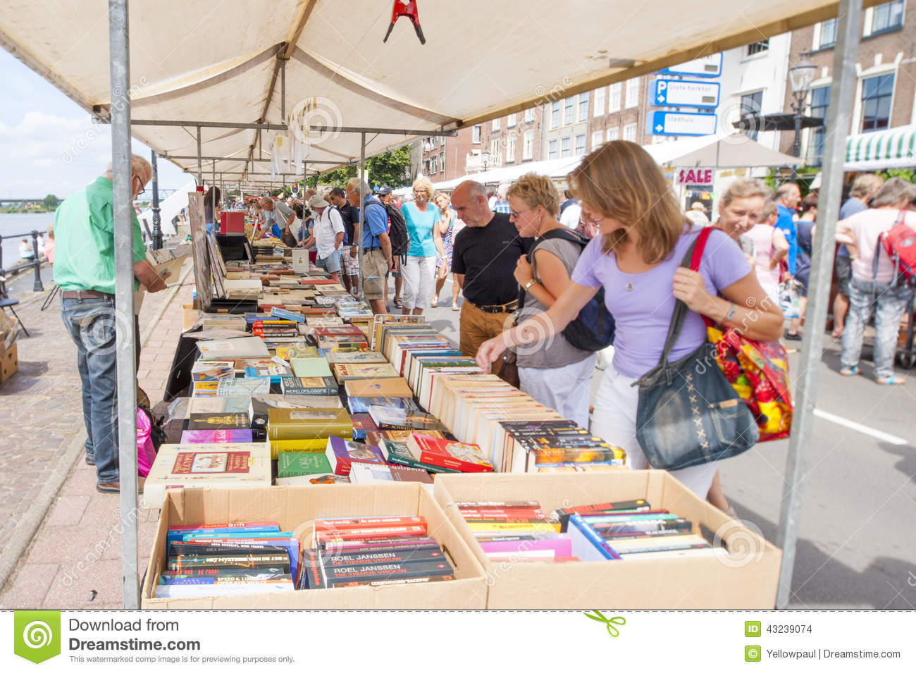 Market Booth With Second Hand Books And Shopping People
