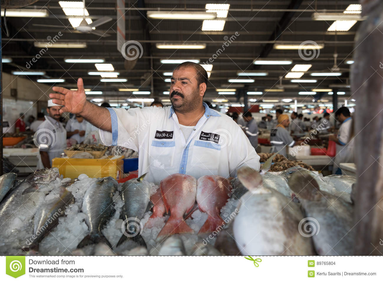 Market Seller Showing His Produce  Editorial Stock Image - Image of