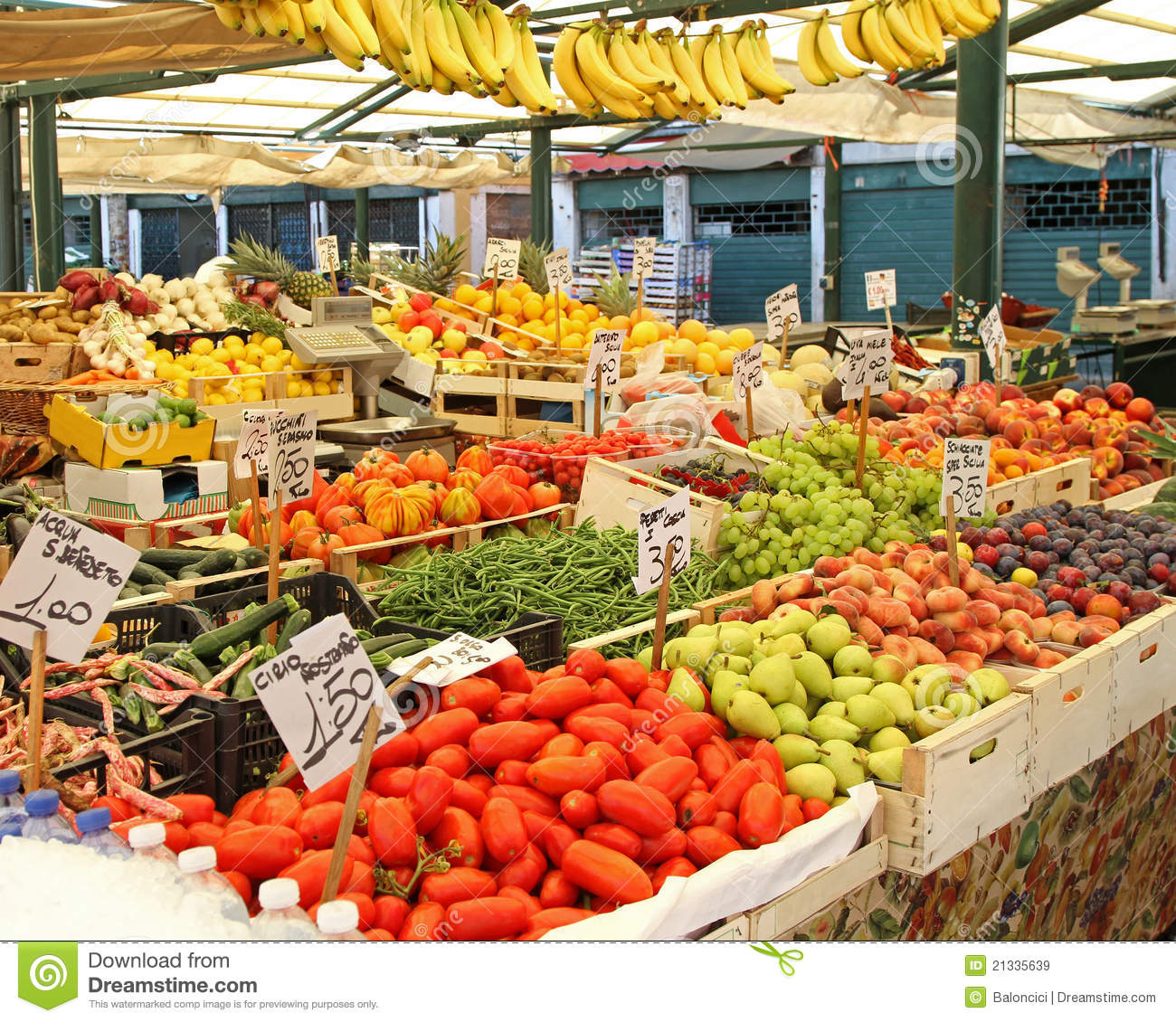 Big farmers market stall filled with organic fruits and vegetables.
