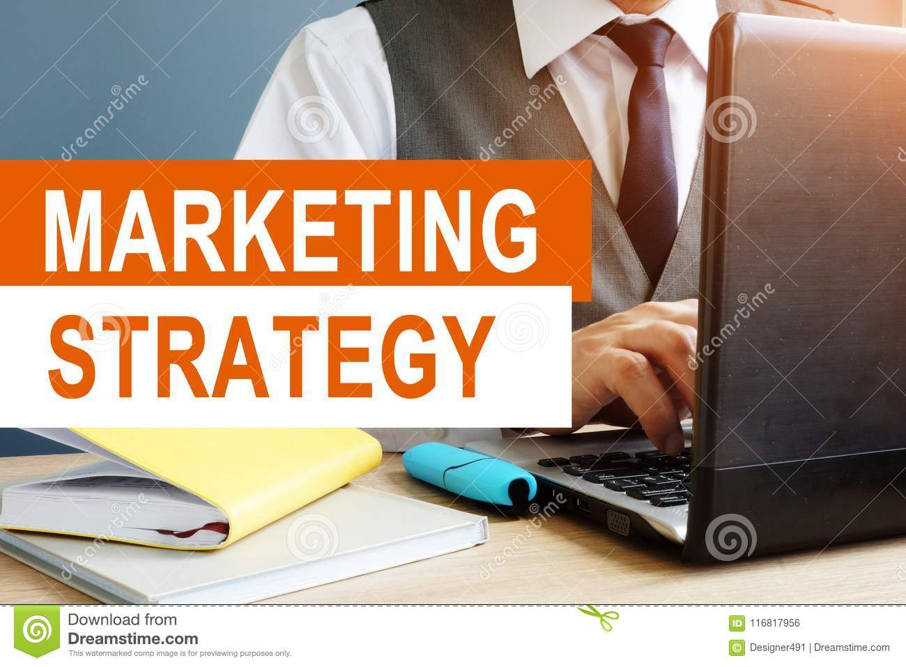 Marketing Strategy concept. Marketer working on laptop.