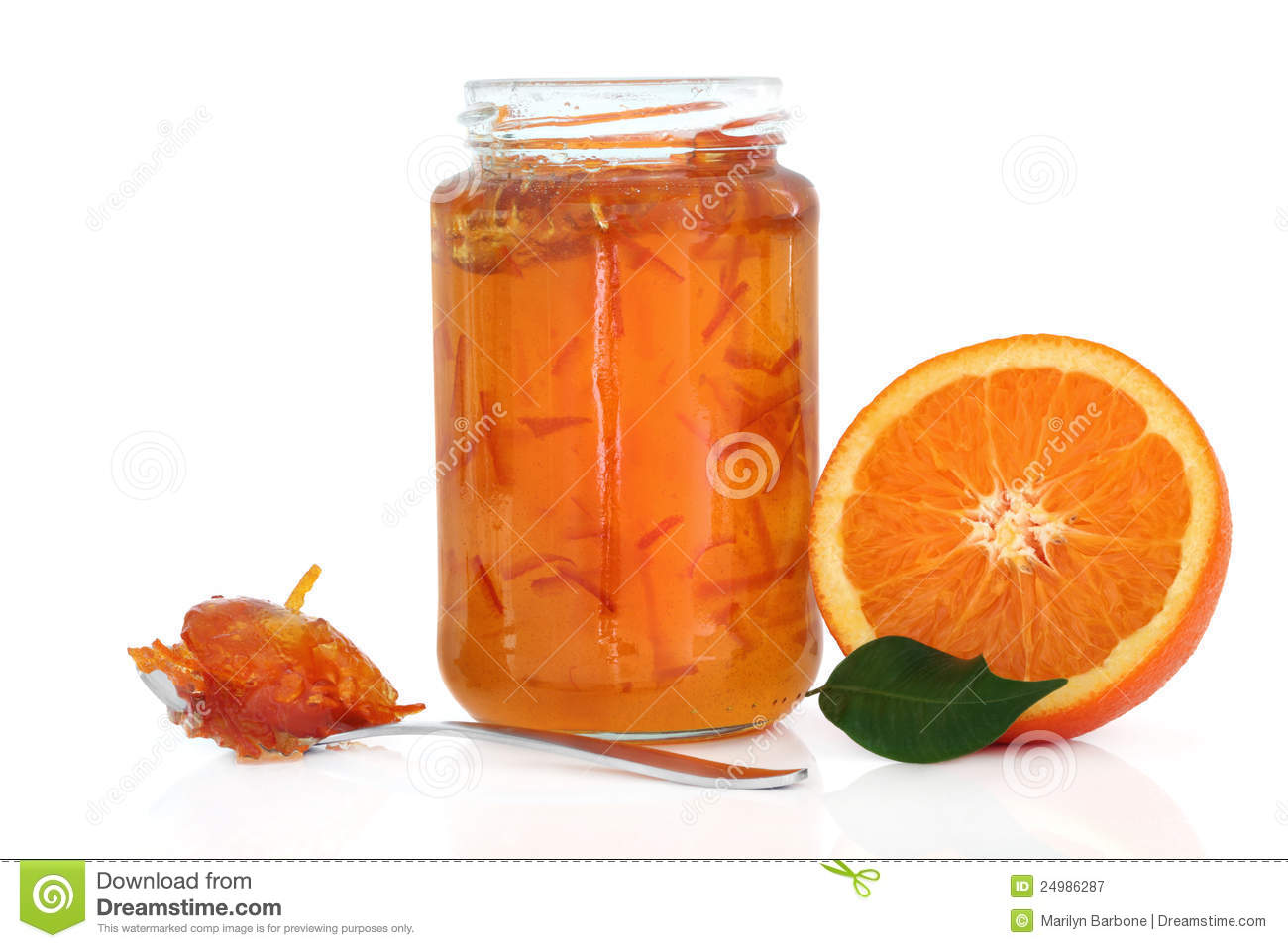 ... with half an orange, leaf and jam in a spoon over white background