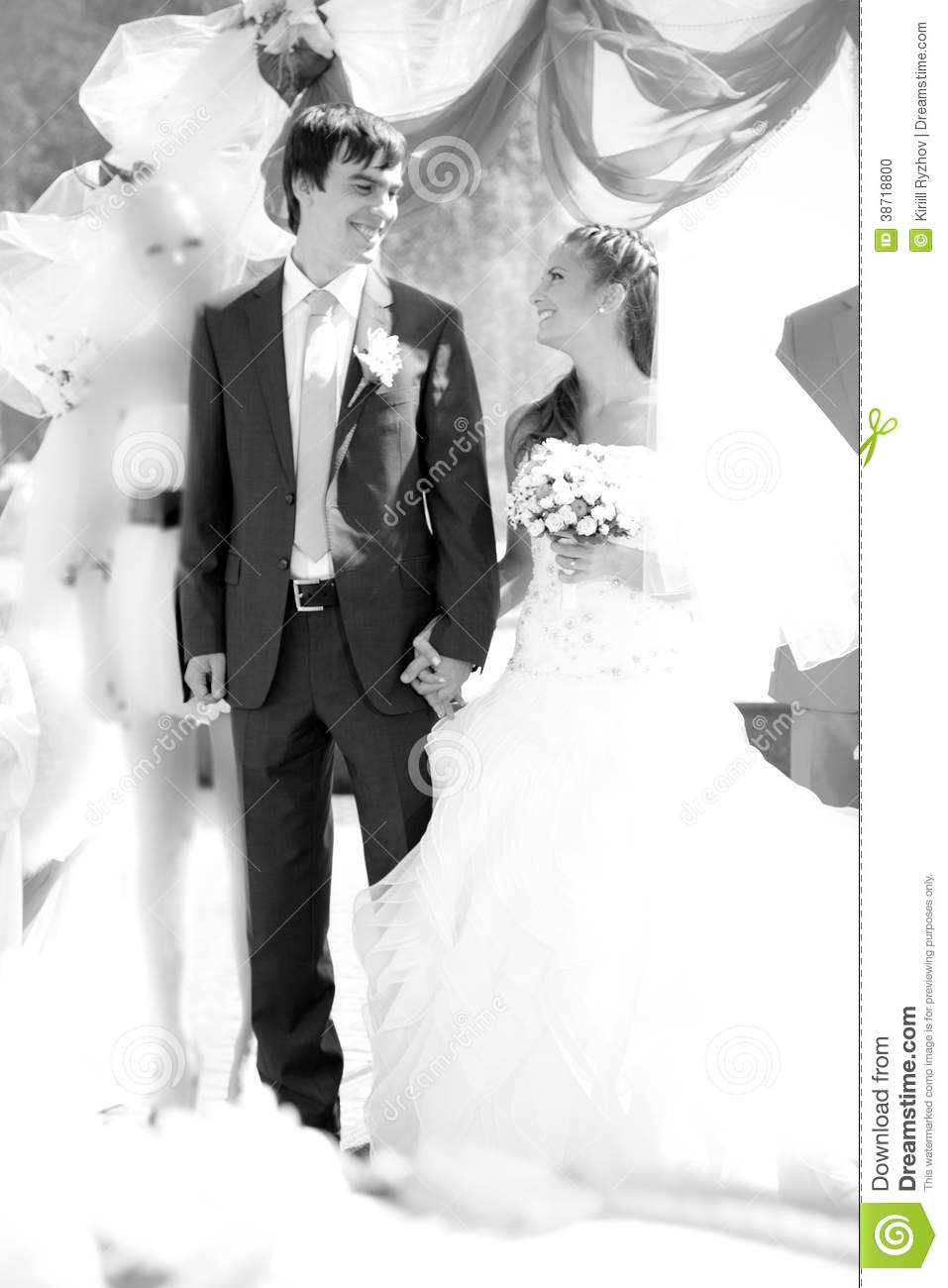 Married Couple Holding Hands Under Decorative Arch Stock ...