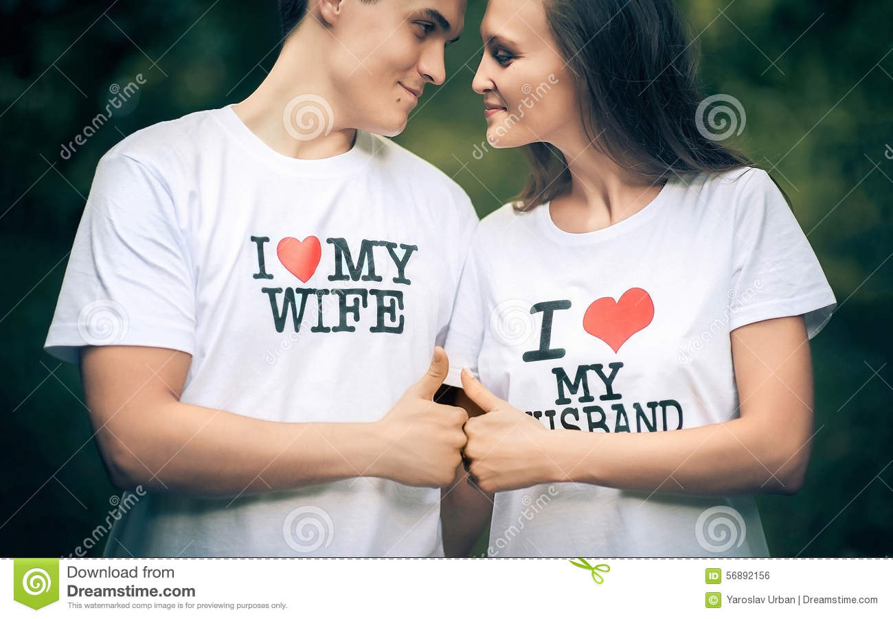 Married couple with words on the T-shirt I love my