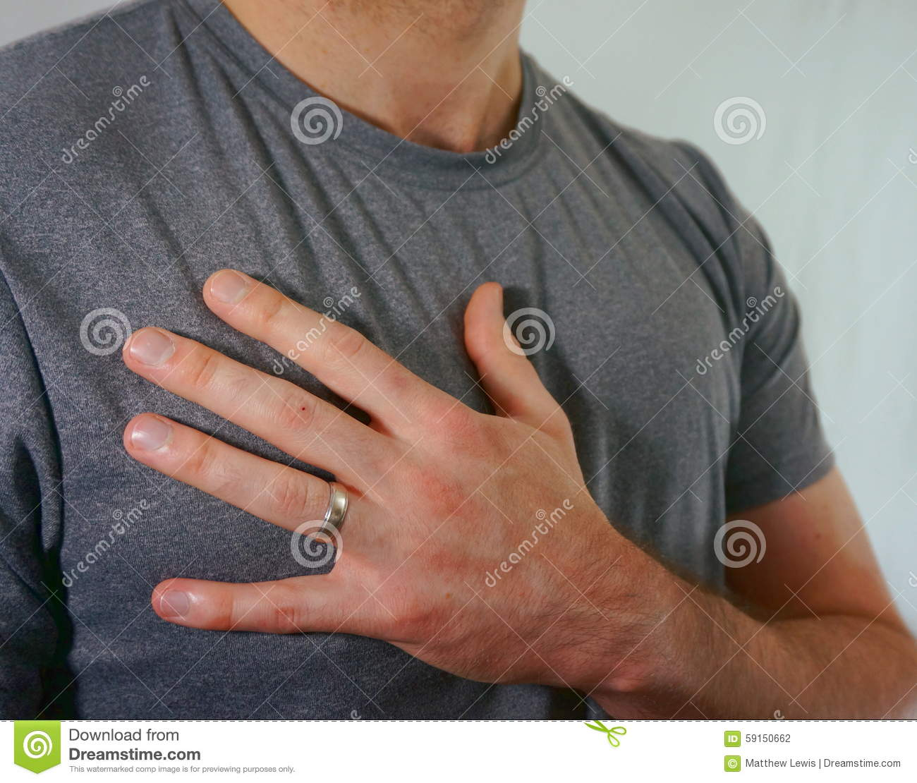 married man wearing wedding ring on hand stock photo