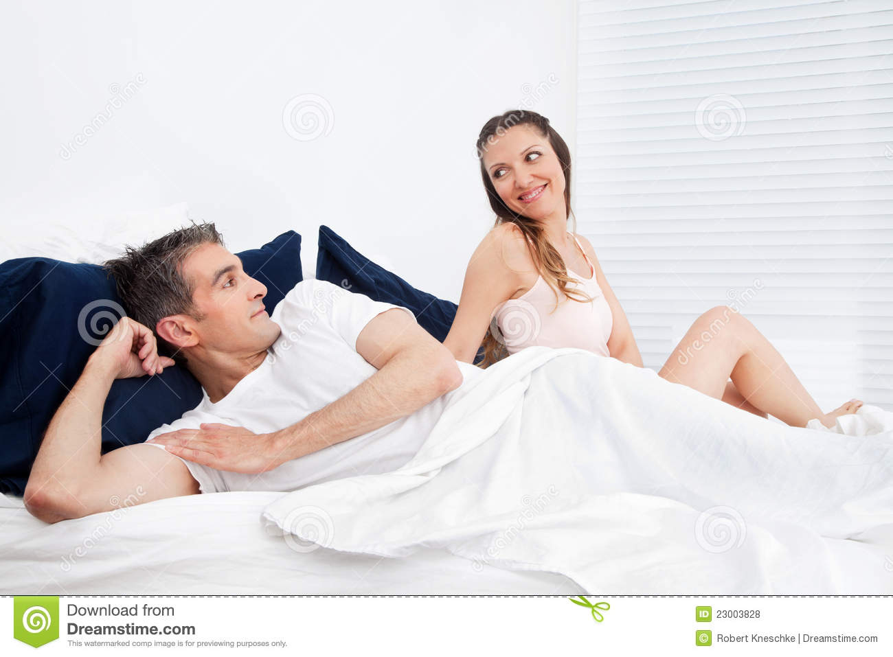 married senior couple in bed royalty free stock photos image 23003828. Black Bedroom Furniture Sets. Home Design Ideas