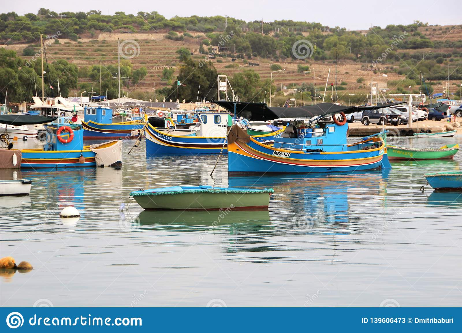 Marsaxlokk, Malta, August 2016. Numerous multi-colored fishing boats in the harbor of the city.