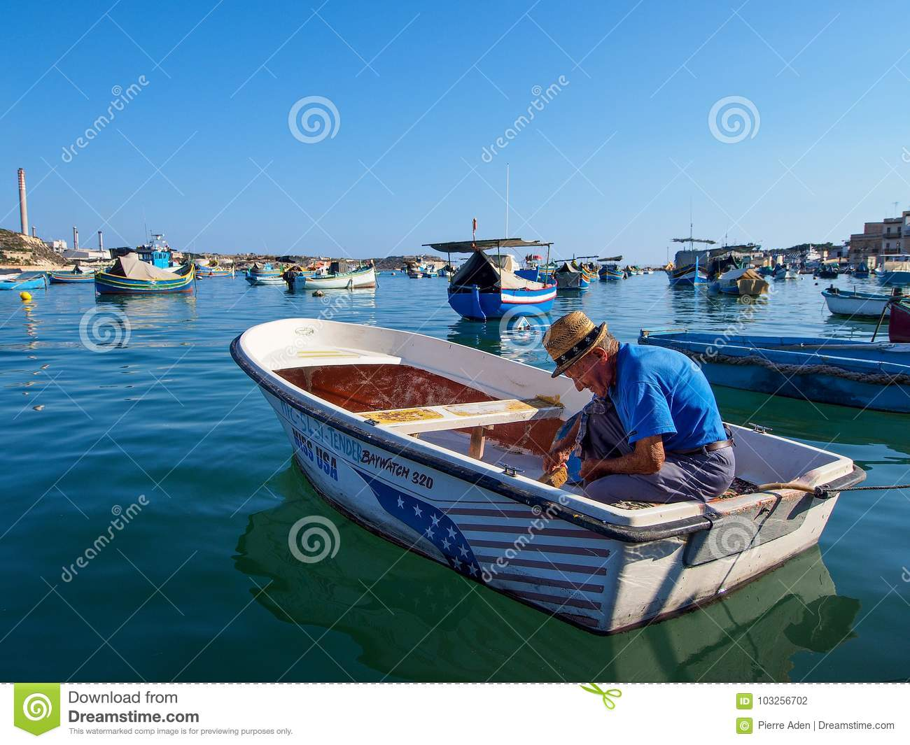 Marsaxlokk, Malta: October 08: Unidentified old man prepares fisher boat on October 08, 2014 in Marsaxlokk, Malta.