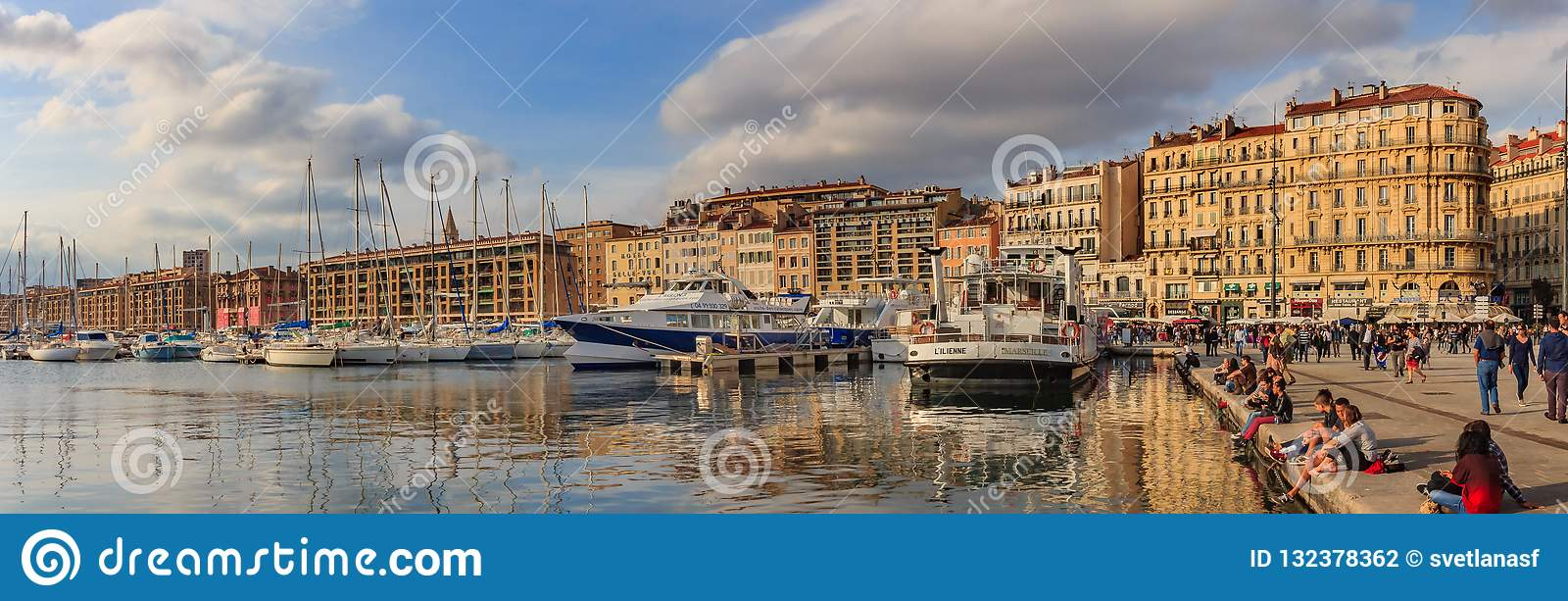 Panoramic view of the old port harbor with docked yachts and col