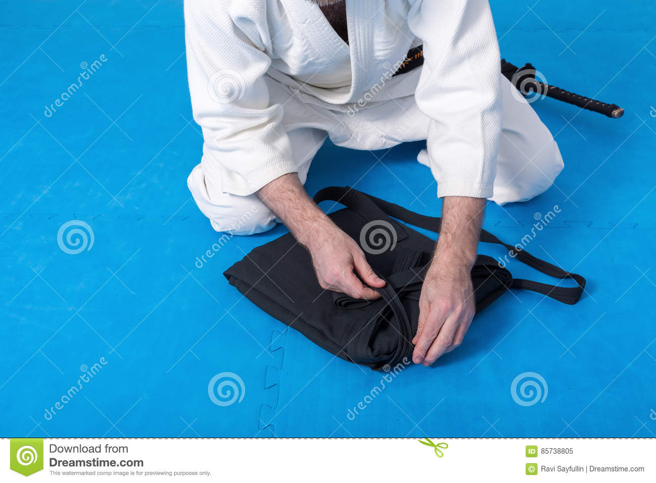 A Martial Arts Master With Black Belt Folding His Hakama Stock Image Image Of Male Lesson 85738805