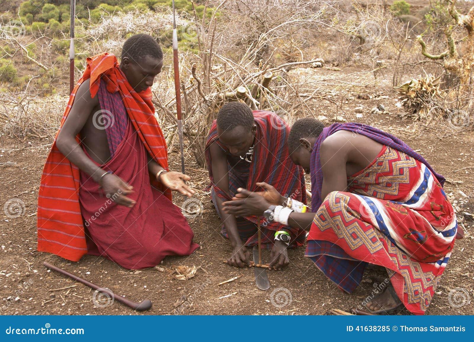 Masai warriors lighting fire