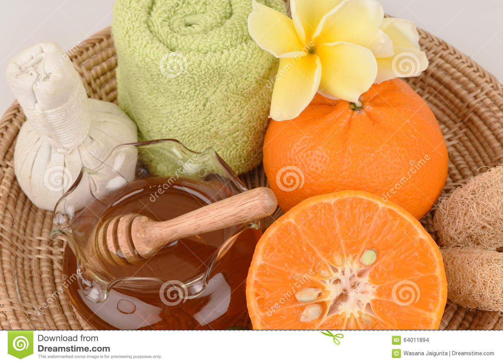 Mascarilla con la naranja y la miel para alisar blanquear la piel y el acné faciales