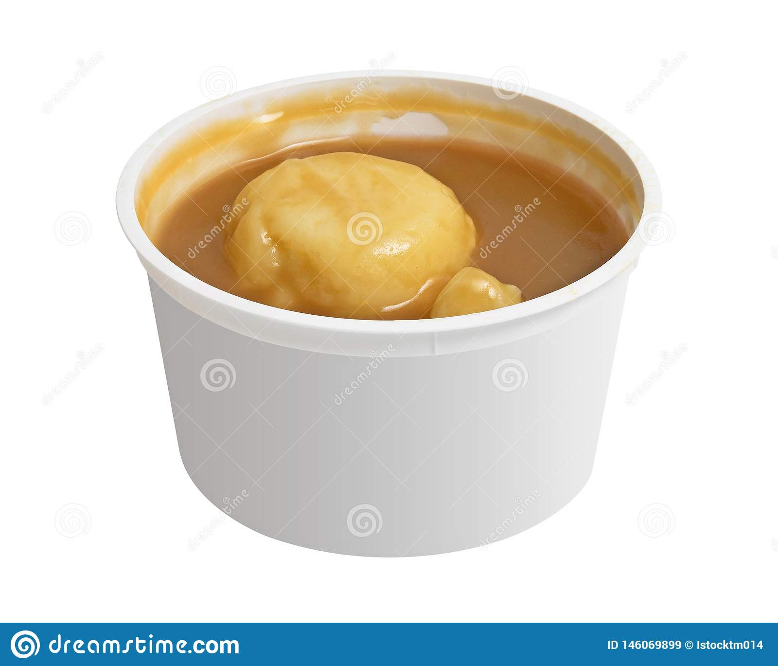 Mashed potatoes in a bowl isolated on white background. Cup of smooth potato puree. Clipping path