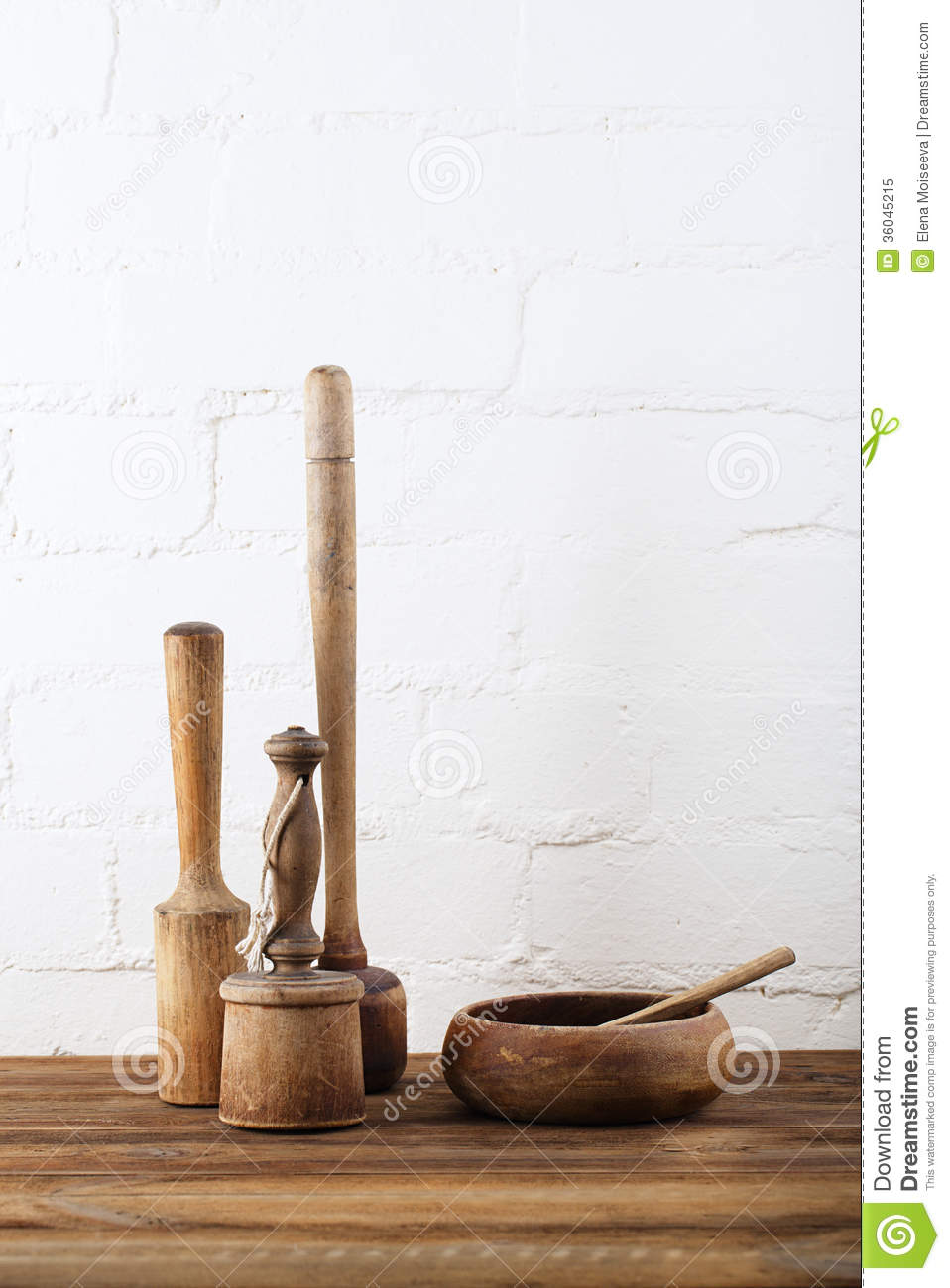Mashers retro kitchen utensils on old wooden table in for Table utensils